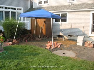 Thinking of having a backyard party, but don't have a good outdoor space where guests can congregate? Then have M. L. Enterprises build a patio—complete with a handsome fire-pit!