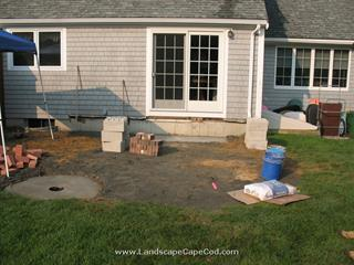 Brick Patio with Fire Pit. Thinking of having a backyard party, but don't have a good outdoor space where guests can congregate? Then have M. L. Enterprises build a patio—complete with a handsome fire-pit!