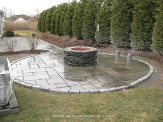 Bluestone patio with fire pit construction.