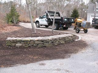 Damaged stone wall repaired in Brewster after being hit by truck backing up.