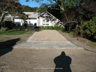 Cobblestone edging and apron set in concrete with shell driveway
