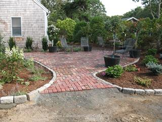 Antique brick paver patio and cobble stone edged driveway installation in Harwich