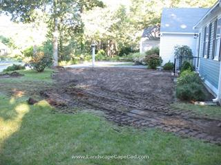 Curved flat stone wall and lawn renovation in Yarmouth Port
