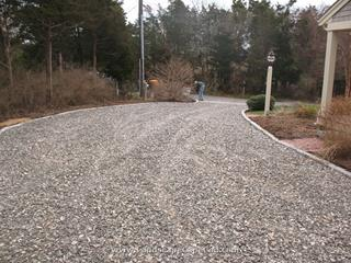 Driveway prep, cobblestone edging and cobble apron installation.